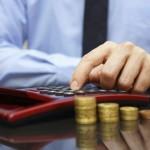 businessman calculating growing savings,